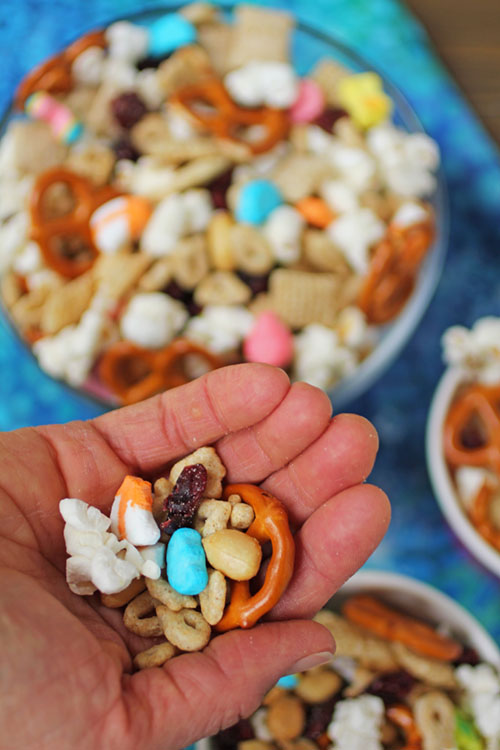 Feeling Lucky Snack Mix is an easy snack mix to make using Lucky Charms, popcorn, pretzels, cranberries, peanuts and vanilla Chex. The perfect marriage of a salty and sweet snack mix!