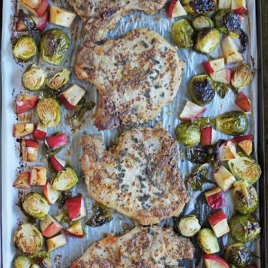 Simple sheet pan dinner don't get much easier or tastier than this one with maple mustard roasted pork chops, Brussels sprouts and apples