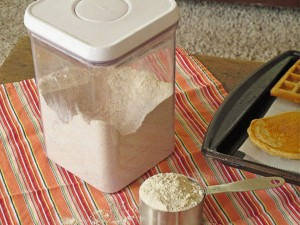 The mix to make pancakes or waffles is stored in an airtight container