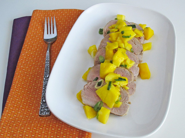 Caribbean Pork Tenderloin with Mango Salsa is simple to prepare and refreshing for a lighter meal.