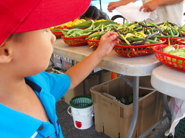 Picking out veggies at the farmers market