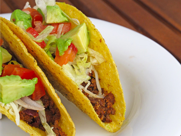 Slow Cooker Beef and Bean Tacos - Fill up a shell or fix up a pretty taco salad- this recipe can be used in a variety of ways and is so yummy!