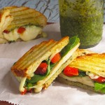 Chicken Pesto Panini is the perfect sandwich for summer using pesto, mozzarella, tomatoes, chicken and fresh basil.