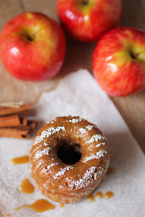 #ad The Best Baked Apple Caramel Donuts we've ever made feature Autumn Glory Apples, are easy to make and combine the best flavors of apples, cinnamon and caramel into a better donut to make everyone happy. #donut #doughnut #apples