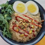 Pressure Cooker Savory Pistachio Oatmeal with Egg, Arugula and Sriracha is a great way to start the day.