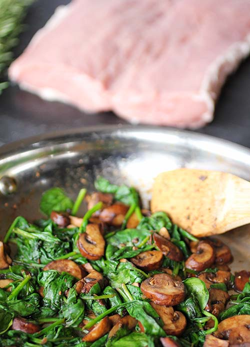 Pork Loin stuffed with goat cheese, spinach and mushrooms is an elegant dinner for a special occasion or easy enough for any night of the week.