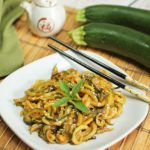 Zoodles are given an Asian twist by cooking in a sauce of miso paste and soy sauce and garnished with sesame seeds.