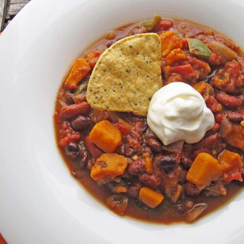 This vegetarian chili with kidney beans, black beans and sweet potatoes is easily made in a slow cooker for a weeknight dinner.